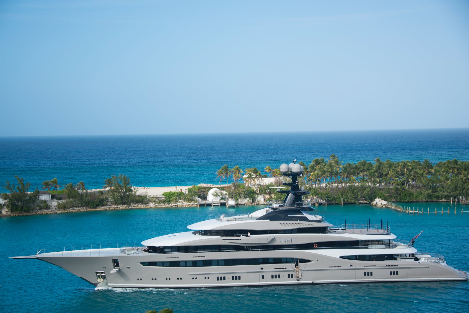 white and blue yacht on body of water