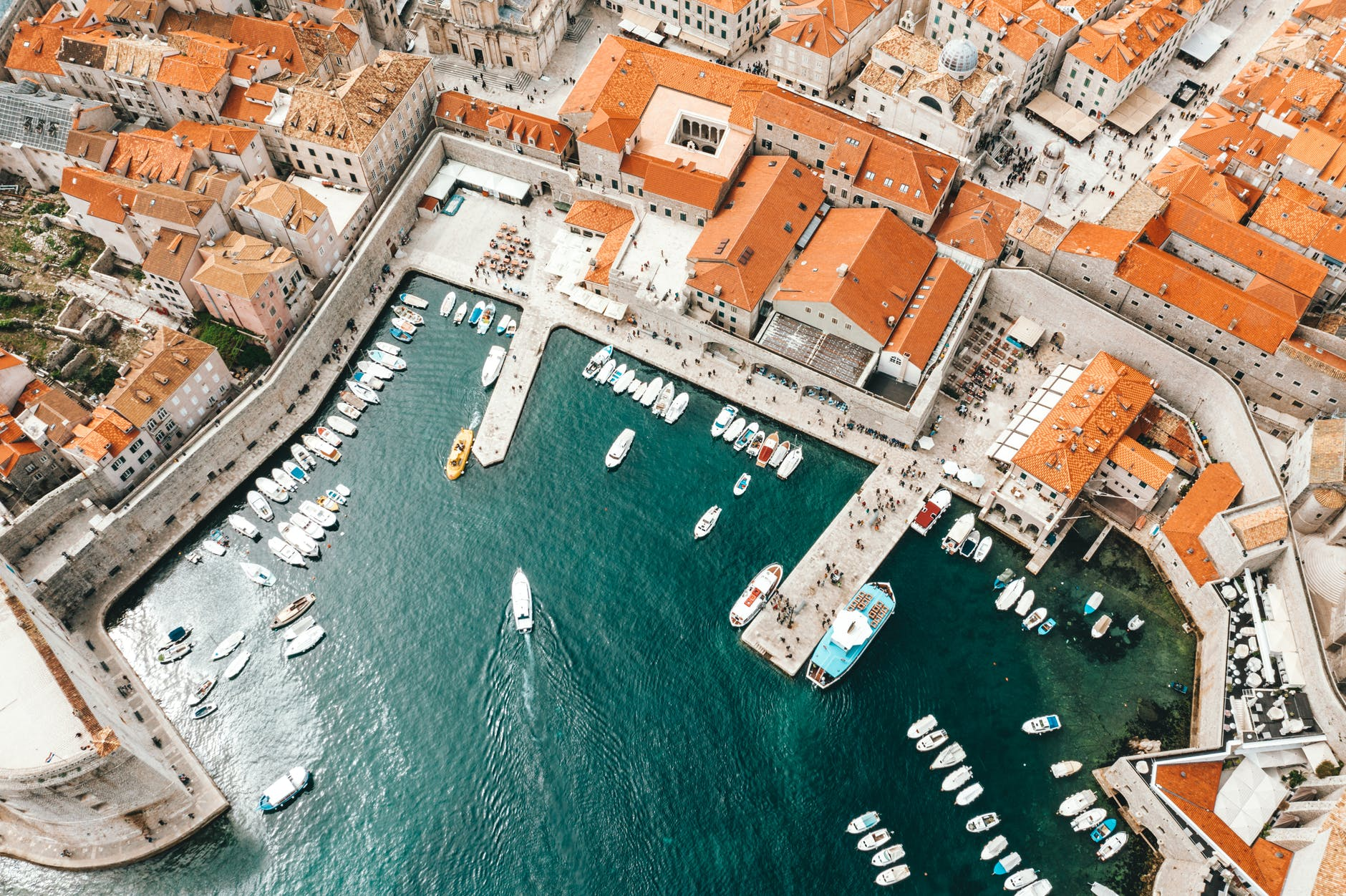 old city port with moored ships and historical houses
